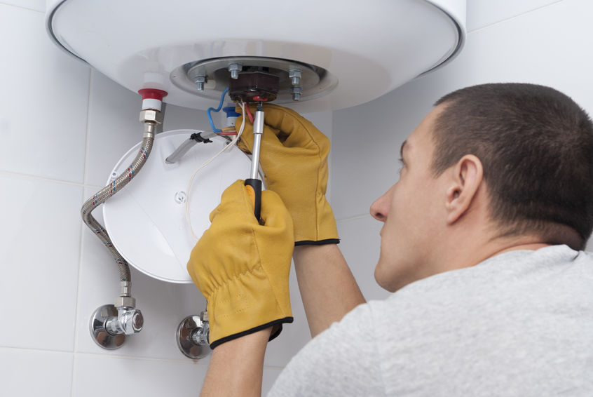 Repairman Connects Wires to Electric Boiler & Thermostat